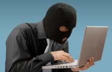 Guy in Ski Mask holding Laptop
